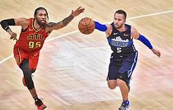 October 24, 2018 - Atlanta, Georgia, U.S. - ATLANTA, GA - OCTOBER 24: Atlanta Hawks forward DeAndre' Bembry (95) tries to knock the ball away from Dallas Mavericks guard J.J. Barea (5) during the third quarter of a NBA game on October 24, 2018 at State Farm Arena in Atlanta, GA. (Photo by Austin McAfee/Icon Sportswire) (Credit Image: © Austin Mcafee/Icon SMI via ZUMA Press)