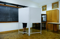 May 26, 2019 - Porto, Portugal - A man is seen casting his vote during the EU Elections at a primary school in Paranhos. (Credit Image: © Omar Marques/SOPA Images via ZUMA Wire)