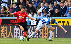 Manchester United's Alexis Sanchez (left) and Huddersfield Town's Erik Durm battle for the ball during the Premier League match at the John Smith's Stadium, Huddersfield.