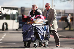© Licensed to London News Pictures. 09/03/2017. Birmingham, UK. A man and woman push their dogs in a cage as they arrive at the 126th annual Crufts dog show at the NEC in Birmingham, West Midlands. The show is organised by the Kennel Club and is the biggest of it's kind in the world.  Photo credit : Ian Hinchliffe/LNP