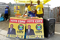 Wednesday 8th May 2019.<br /> Monwabisi Park, Harare,<br /> Khayelitsha, Cape Town, <br /> Western Cape, <br /> South Africa.<br /> <br /> SOUTH AFRICAN GENERAL ELECTIONS 2019!<br /> <br /> SOUTH AFRICAN PROVINCIAL AND NATIONAL ELECTIONS 2019! <br /> <br /> COPE supporters pose for a photo together outside the voting station at Monwabisi Park, Harare in Khayelitsha near Cape Town, Western Cape, South Africa.<br /> <br /> Registered South African Voters head to the various IEC (Independent Electoral Commission) Voting Stations where they are registered to vote as they cast their votes and take part in voting and other activities on Voting Day 8th May 2019 during the South African General Elections 2019. Voters from across the nation stood in queue's along with many others to vote in the Provincial and National Elections being held in South Africa on Wednesday 8th May 2019.   <br />  <br /> Copyright © Mark Wessels. All Rights Reserved. No Usage Without Permission.<br /> <br /> PICTURE: MARK WESSELS. 08/05/2019.<br /> +27 (0)61 547 2729.<br /> mark@sevenbang.com<br /> studioseven@mweb.co.za<br /> www.markwesselsphoto.com