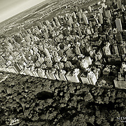 A higher up aerial view above Central Park, with the Metropolitan Museum of Art seen to the middle left, and the Upper East Side cityscape dominating the scene.