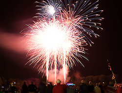 © Licensed to London News Pictures.22/08/15<br /> Castle Howard, North Yorkshire, UK. <br /> <br /> A firework display brings the night to a close as hundreds of people attend the 25th anniversary of the Castle Howard Proms event near York. The theme of the event this year is a commemoration of the 75th anniversary of the Battle of Britain and the 70th anniversary of VE day and brings an evening of classic musical favourites celebrating Britishness to the lawns of Castle Howard.<br /> <br /> Photo credit : Ian Forsyth/LNP