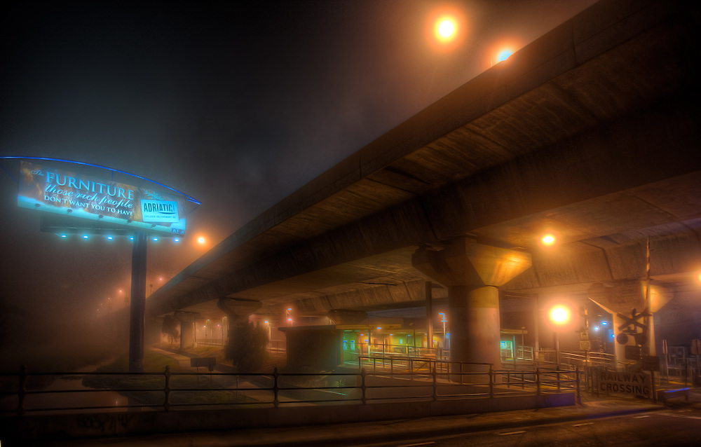 Railway Stations at night. About 9:30 Macaulay railway station under heavey fog. The station is built under the CityLink Tollway. Pic By Craig Sillitoe CSZ/The Sunday Age/The Age iPad App.28/06/2011 This photograph can be used for non commercial uses with attribution. Credit: Craig Sillitoe Photography / http://www.csillitoe.com<br /> <br /> It is protected under the Creative Commons Attribution-NonCommercial-ShareAlike 4.0 International License. To view a copy of this license, visit http://creativecommons.org/licenses/by-nc-sa/4.0/.