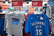 An old Oklahoma City Thunder t-shirt with Kevin Durants number sits on the clearance rack for $4.97 at a local sporting goods store in Durant, Oklahoma on January 27, 2017.  (Cooper Neill for The New York Times)