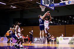 Marcus Delpeche of Bristol Flyers is blocked by Henry Wilkins of Worcester Wolves - Photo mandatory by-line: Robbie Stephenson/JMP - 02/12/2020 - BASKETBALL - University of Worcester Arena - Worcester, England - Worcester Wolves v Bristol Flyers - British Basketball League Cup
