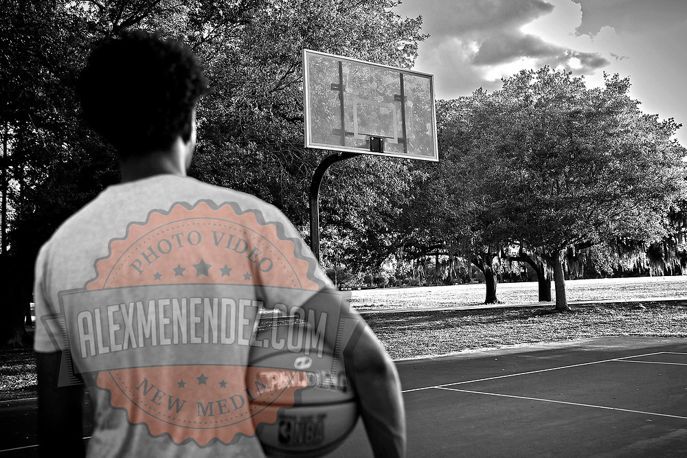 Student Austin James reacts after the City of Orlando parks and recreation division pulled down basketball hoops to break up groups from gathering and to social distance each other due to the Coronavirus (Covid-19) outbreak on Tuesday, April 7, 2020 in Orlando, Florida. (Alex Menendez via AP)