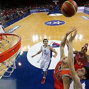 Anadolu Efes's Emircan Kosut (R) during their BEKO Basketball League match Anadolu Efes between Banvit at Abdi Ipekci Arena in Istanbul Turkey on Sunday 05 January 2014. Photo by TURKPIX
