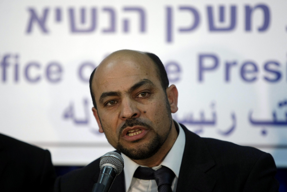 Israeli-Arab elected lawmaker Masud Ghnaim of the Ta'al party speaks to the press at the Residence of the Israeli President in Jerusalem, Israel, on February 19, 2009.