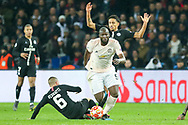 Manchester United Forward Romelu Lukaku avoids a tackle from Marco Verratti of Paris Saint-Germain and Marquinhos of Paris Saint-Germain during the Champions League Round of 16 2nd leg match between Paris Saint-Germain and Manchester United at Parc des Princes, Paris, France on 6 March 2019.