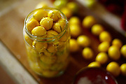 Home made olive curing. Cut olives are placed in a jar with brine