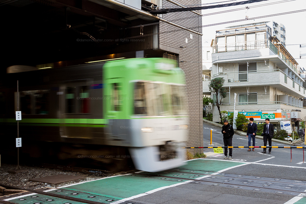 A Keio 1000 series train with the Keio Inokashira Line train leaves Shinsen Station in Shibuya, Tokyo, Japan. Wednesday November 21st 2018