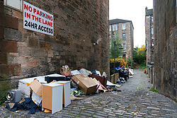 Glasgow, Scotland, UK. 23rd October 2021. Domestic waste is seen discarded in the streets of Govanhill in Glasgow with one week to the start of the UN Climate Change Conference COP26 in the city. City refuse collectors have said they will strike during the conference leading to fears that the city streets will be full of rubbish whist in the world's spotlight.  Iain Masterton/Alamy Live News.