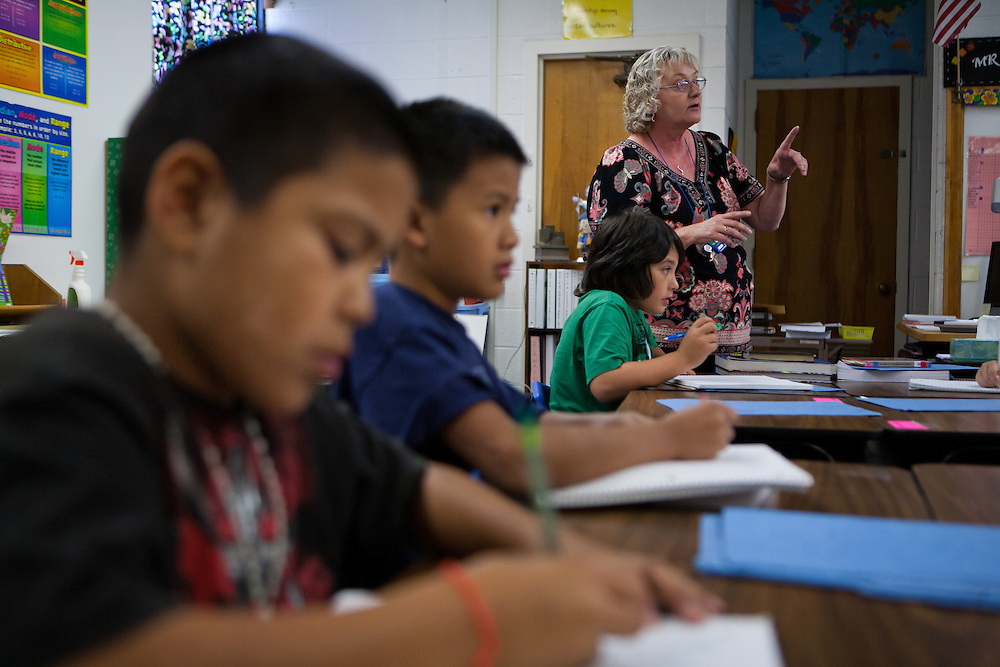 Lovington schools 4th grade teacher Vickie Auld works with students. The schools in Lea County are using Recovery and Reinvestement funds to pay for much needed teachers like Auld.