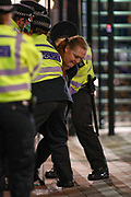 A woman who in solidarity with slain Sara Everard slit her wrists outside New Scotland Yard on late Sunday, March 14, 2021, is being arrested by the police in an attempt to prevent her from further hurting herself an officer briefly said.  <br /> Protestors demonstrated outside New Scotland Yard and continued in Parliament square against Police aggression are calling London's Metropolitan Police force to explain its actions during a vigil for Sarah Everard whom one of the force's own officers is accused of murdering her. (VXP Photo/ Vudi Xhymshiti)