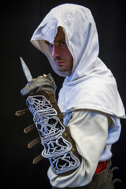 Ryan Small (pictured), 936 (or really 23) from Enfield, plays Altair. He comes with his friend Edward Kenway, 240-ish (or really 33) from Essex, who plays Azriel Grimm. Both are from Assasins Creed and are members of Assasins Cosplay Brotherhood UK on facebook. London Film and Comic Con 2014, (LFCC), at Earls Court, London, UK.
