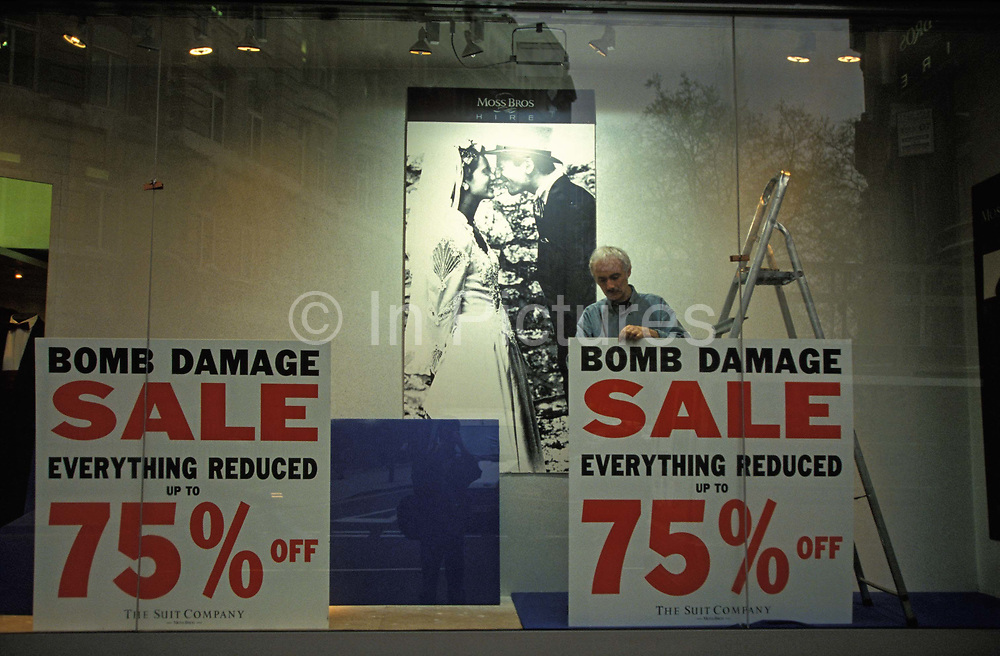 Days after the Irish Republican Army IRA exploded a truck bomb on Bishopsgate, a main arterial road that travels north-south through Londons financial area, City of London, bomb damaged stock goes on sale at reduced prices in a branch of menswear outfitters, Moss Bross at Liverpool Street Station. on 26th April 1993, in London, England. One person was killed when the one ton fertiliser bomb detonated directly outside the medieval St Ethelburgas church. Buildings up to 500 metres away were damaged, with one and a half million square feet 140,000 m² of office space being affected and over 500 tonnes of glass broken. Costs of repairing the damage was estimated at £350 million. It was possibly the IRAs most successful military tactic since the start of the Troubles.