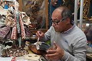 Abraham Aller Escalante at work in his showroom in San Blas