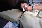 Nederland, Nijmegen, 3-4-2005..Vrouw niest in bed. Huismijt, stof, pollen, huisstof, allergie,hooikoorts,niezen, griep, verkoudheid, papieren zakdoek...Foto: Flip Franssen
