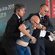 VENICE, ITALY - JUNE 04:  A man protesting against Biennale policy is removed from the stage during the Official Awards  of the 54th International Art Exhibition on June 4, 2011 in Venice, Italy. This year's Biennale is the 54th edition and will run from June 4th until 27 November.