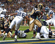 St. Louis running back Steven Jackson (39) rushes past Seattle's Ken Hamlin (26) for a touchdown second quarter touchdown, at the Edward Jones Dome in St. Louis, Missouri, October 15, 2006.  The Seahawks beat the Rams 30-27.<br />