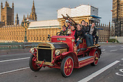 A vintage fire engine - Going over Westminster Bridge - Bonhams London to Brighton Veteran Car Run celebrates the 122nd anniversary of the original Emancipation Run of 1896 which celebrated the passing into law the Locomotives on the Highway Act so raising the speed limit for 'light automobiles' from 4mph to 14mph and abolishing the need for a man to walk in front of all vehicles waving a red flag. The Movember Foundation as our Official Charity Partner.