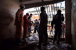 April 3, 2017 - Mocoa, Colombia - Rescue workers stand next to a corpse in a zone affected by the landslid. Rescue work keeps on going in Colombia's southwest city of Mocoa, in the department of Putumayo, early Sunday, following a tragic mudslide that devastated 17 neighborhoods and killed 207. (Credit Image: © Juan Zarama Perini/Xinhua via ZUMA Wire)