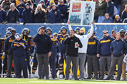 Nov 10, 2018; Morgantown, WV, USA; West Virginia Mountaineers offensive coordinator Jake Spavital calls in a play from the sidelines during the second quarter against the TCU Horned Frogs at Mountaineer Field at Milan Puskar Stadium. Mandatory Credit: Ben Queen-USA TODAY Sports