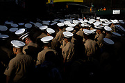 Members of the United States Marine Corps gather for their photo shoot at the red steps at Times Square during the Fleet Week on May 22, 2019 in Manhattan, New York.