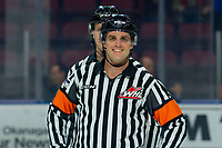 KELOWNA, BC - MARCH 11: Referee Steve Papp hams it up for the camera at the start of the game between the Kelowna Rockets and the Victoria Royals at Prospera Place on March 11, 2020 in Kelowna, Canada. (Photo by Marissa Baecker/Shoot the Breeze)