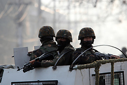 December 17, 2018 - Srinagar, Jammu and Kashmir, India - Indian soldiers keep vigil from top of a vehicle in Srinagar the summer capital of Indian controlled Kashmir on December 17, 2018. Police used teargas canisters and stun grenades after anti-India clashes erupt in Maisuma area of Srinagar soon after the separatist leader Yasin Malik was detained who took out a protest march against the killing of seven civilians and three militants by Indian army south Kashmir's Pulwama on December 15. Kashmiri Resistance Leadership (JRL) had called for a shutdown and march to Indian army base in Srinagar to protest the killings of seven civilians over the weekend in Pulwama. (Credit Image: © Faisal KhanZUMA Wire)