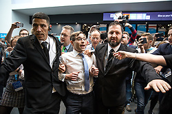 © Licensed to London News Pictures . 04/10/2017. Manchester, UK. Stunt comedian SIMON BRODKIN (aka Lee Nelson ) is ejected from the conference hall by security guards after handing Prime Minister Theresa May a P45 form during her keynote speech on the fourth and final day of the Conservative Party Conference at the Manchester Central Convention Centre . Brodkin said Boris Johnson told him to do it . Photo credit: Joel Goodman/LNP