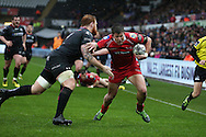 DTH Van Der Merwe of Scarlets ® runs in to score his 1st half try as Dan Baker of the Ospreys attempts to stop him.Guinness Pro12 rugby match, Ospreys v Scarlets at the Liberty Stadium in Swansea, South Wales on Saturday 26th March 2016.<br /> pic by  Andrew Orchard, Andrew Orchard sports photography.