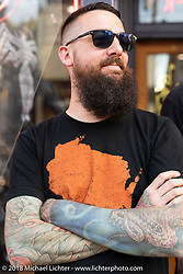 Ryan Wetherbee of Saints and Sinners Tattoo Co on Brady during the Brady Street Experience, where Brady was closed to 4-wheelers and a street party raged until late at night during the Harley-Davidson 115th Anniversary Celebration event. Milwaukee, WI. USA. Friday August 31, 2018. Photography ©2018 Michael Lichter.