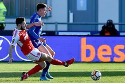 Fleetwood Towns' Lewie Coyle tackles Leicester City's Harvey Barnes