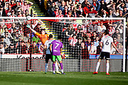 Sheffield Utd goalkeeper Dean Henderson (1) can't stop the equaliser from Bristol City forward Andreas Weimann (14)  1-1 during the EFL Sky Bet Championship match between Sheffield United and Bristol City at Bramall Lane, Sheffield, England on 30 March 2019.