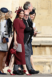 US actress Demi Moore leaves after attending the wedding of Princess Eugenie and Jack Brooksbank at St George's Chapel, Windsor Castle, in Windsor.
