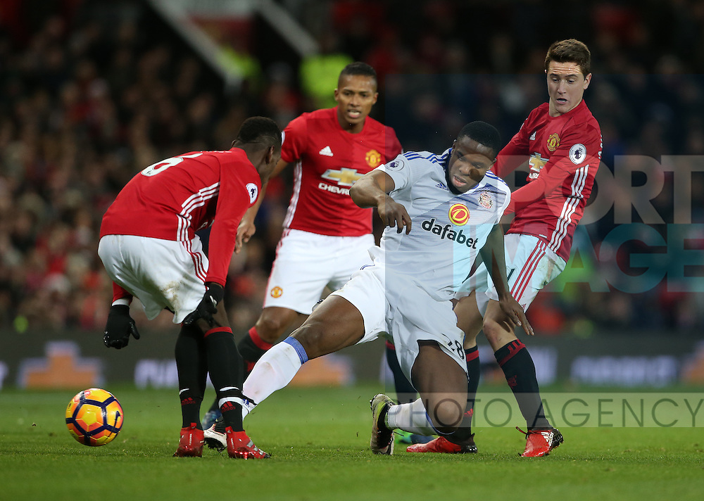 Manchester United's Paul Pogba and Ander Herrera tussle with Sunderland's Victor Anichebe during the Premier League match at Old Trafford Stadium, London. Picture date December 26th, 2016 Pic David Klein/Sportimage