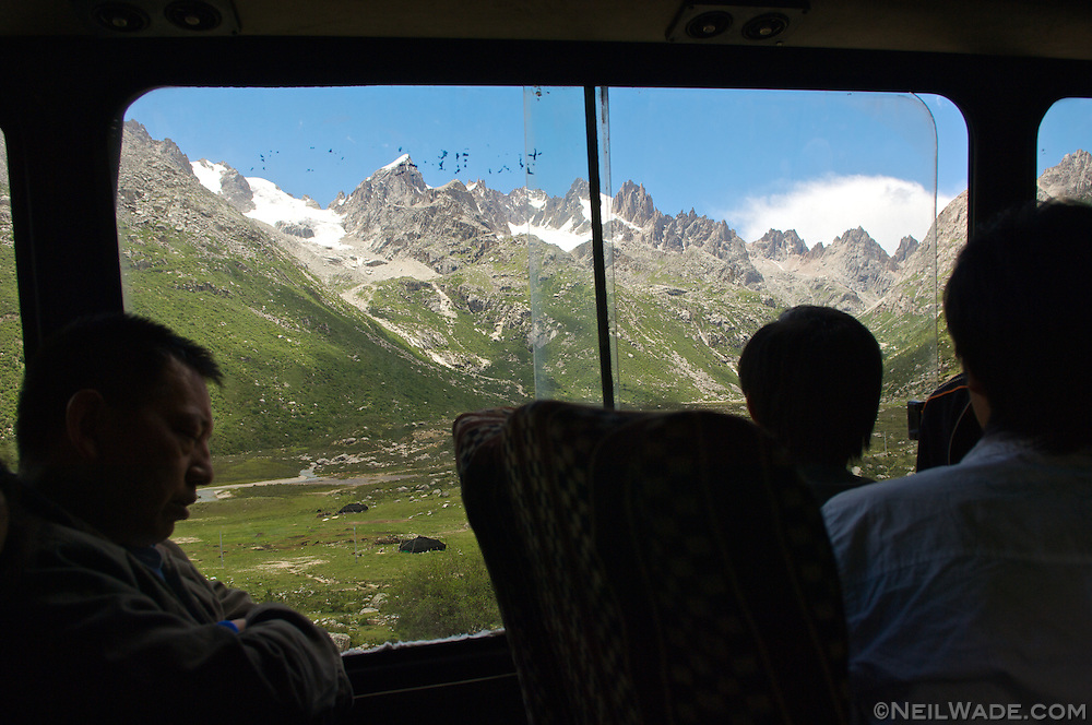 A look out the window of a bus ast it ascend towards the Tro La (Chola) Pass on the Northern Sichuan-Tibet Highway, near Dege, Tibet.