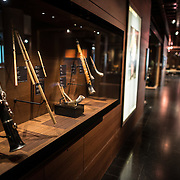 Wind instruments on display at the Musical Instrument Museum in Brussels. The Musee des Instruments de Musique (Musical Instrument Museum) in Brussels contains exhibits containing more than 2000 musical instruments. Displays include historical, exotic, and traditional cultural instruments from around the world. Visitors to the museum are given handheld audio guides that play musical demonstrations of many of the instruments. The museum is housed in the distinctive Old England Building.
