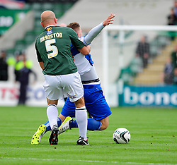 Bristol Rovers' Ryan Brunt is fouled by Plymouth Argyle's Guy Branston  - Photo mandatory by-line: Dougie Allward/JMP - Tel: Mobile: 07966 386802 07/09/2013 - SPORT - FOOTBALL -  Home Park - Plymouth - Plymouth Argyle V Bristol Rovers - Sky Bet League Two
