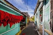 Fine Art: Back alley of the Ancient City along with red napkins drying and a colorful architecture. Fine Art. RAW to Jpg.