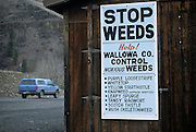 A sing reminds motorists entering Wallowa County in Northeast Oregon to take appropriate measures again invasive and toxic weeds. The weeds pose a hazard to grazing livestock but also disrupt native habitat and displace or eliminate native plants.