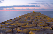A stone pier in evening light. Sitges, Catalonia, Spain