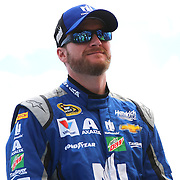 Race car driver Dale Earnhardt Jr. is seen during driver introductions prior to the 58th Annual NASCAR Daytona 500 auto race at Daytona International Speedway on Sunday, February 21, 2016 in Daytona Beach, Florida.  (Alex Menendez via AP)