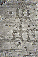 """Petroglyph, rock carving, of one schematic human figures in the so called """"Prayer"""" position. Carved by the ancient Camunni people in the Late Copper Age between 3200- 2200 BC. Rock no 24,  Foppi di Nadro, Riserva Naturale Incisioni Rupestri di Ceto, Cimbergo e Paspardo, Capo di Ponti, Valcamonica (Val Camonica), Lombardy plain, Italy .<br /> <br /> Visit our PREHISTORY PHOTO COLLECTIONS for more   photos  to download or buy as prints https://funkystock.photoshelter.com/gallery-collection/Prehistoric-Neolithic-Sites-Art-Artefacts-Pictures-Photos/C0000tfxw63zrUT4<br /> If you prefer to buy from our ALAMY PHOTO LIBRARY  Collection visit : https://www.alamy.com/portfolio/paul-williams-funkystock/valcamonica-rock-art.html"""