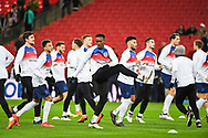 England Forward Danny Welbeck (24) and the England team warm up ahead of the Friendly match between England and Italy at Wembley Stadium, London, England on 27 March 2018. Picture by Stephen Wright.