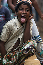 February 6, 2018 - Cox'S Bazar, Bangladesh - A young Rohingya boy shows his tongue while posing for a photo in Kutupalong refugee camp in Cox's Bazar. More than 800,000 Rohingya refugees have fled from Myanmar Rakhine state since August 2017, as most of them keep trying to cross the border to reach Bangladesh every day. (Credit Image: © Marcus Valance/SOPA via ZUMA Wire)