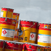 Scenes from a ship yard in Dubai. Tins of paint.