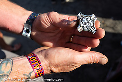 Custom bike builder Hawke Lawshe of Vintage Technologies shows off his Best of Show ring designed and made by Frank Rodriguez who made rings for all of the 1st placer winners at the Rats Hole annual custom bike show at the Buffalo Chip during the Sturgis Black Hills Motorcycle Rally. SD, USA. Thursday, August 8, 2019. Photography ©2019 Michael Lichter.
